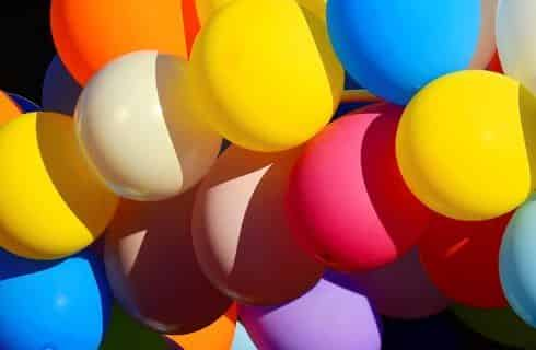 Close up view of multicolored balloons grouped together